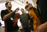 MJM215  Joel Noble (cq), left, instructs his East High School shop class as Rory McGuire (cq), 14,...