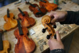 MJM449  Jesus Cabeza, 16, (cq) works on violins in Joel Noble's East High School shop class...