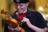 MJM636  Shawn Wall (cq), 14, works on a violin in Joel Noble's East High School shop class...