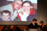 (PG4597) Jim Sheeler comforts Melissa Givens after she read letters her husband, Army PFC Jesse...