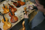 MJM441  Jesus Cabeza, 16, (cq) works on violins in Joel Noble's East High School shop class...