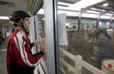 DM0008  Michael Meeks, 24, gets ready to ride at the Praying Hands Ranch in Parker, Colo. Thursday...