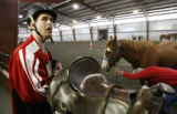 DM0011  Michael Meeks, 24, gets ready to ride at the Praying Hands Ranch in Parker, Colo. Thursday...