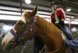 DM0045  Michael Meeks, 24, climbs aboard Poe the horse as he rides at the Praying Hands Ranch in...