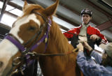 DM0047  Michael Meeks, 24, climbs aboard Poe the horse as he rides at the Praying Hands Ranch in...
