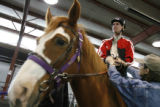 DM0049  Michael Meeks, 24, climbs aboard Poe the horse as he rides at the Praying Hands Ranch in...