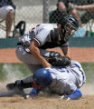 Chatfield catcher Jake Davis tags out Cherry Creek player T J Shantz during a attempted squeeze...