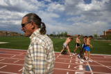 Colorado Buffalo head track coach Mark Wetmore (cq) walks away while his steeplechase team begins...