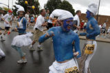 DM1857  Dressed as Smurfs Brent Abbott and his friends dance their way up Folsom Street during the...