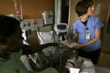 (060) Kalina Miller, a nursing student, says checks blood pressure on one of her patients, Gerald...