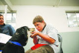 Michael, 14, (cq) stares down Brodie, (cq) a hound mix, during a training session. Rita Benavidez,...