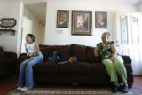 11 year-old Valeria Rocha (cq), and her mother, Adriana Rocha (cq) sit in their living-room couch...