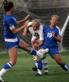 (PG5849) After a kick by Cherry Creek's Kristen Miller, Arapahoe's Laura Feehs (left) battles...