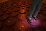DM0848  Facility manager Ted Borst kneels atop the shield plugs that cover the containers filled...