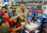 XSR301 - Yankee first baseman Jason Giambi helps young fans cast their MLB All-Star Game ballots...