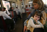 255  Kathy Kelly-Weston (cq) holds her granddaughter, Ava Kelly, 5, as they ride a light rail...