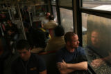 323  Passengers ride a southbound light rail train near the University of Denver Wednesday...