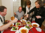EJ376  Food Diary with artist Phil Bender, center.  He has dinner with friends at the home of...