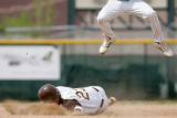 Michael Mankoff, of Thomas Jefferson, slides into second base as  against Fossil Ridge in the...