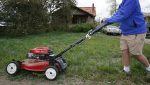 DM0136  Terry Smith mows the lawn of his house at 5301 W. 10th Ave. in Lakewood, Colo. His...