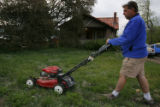 DM0151  Terry Smith mows the lawn of his house at 5301 W. 10th Ave. in Lakewood, Colo. His...