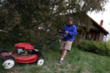 DM0176  Terry Smith mows the lawn of his house at 5301 W. 10th Ave. in Lakewood, Colo. His...