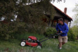 DM0184  Terry Smith mows the lawn of his house at 5301 W. 10th Ave. in Lakewood, Colo. His...