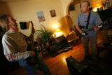 DM0356  Robert Guy, right, jams out with his tenant Joe Pierce during a recent visit to the house...