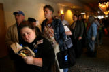 (PG6493)  Diane Lauer, of Loveland, waits in line for registration at the Democratic State...