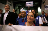 (PG7775)  Surrounded by supporters, Democratic U.S. Senate nominee Mark Udall (left) checks out...