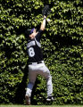 CXC106 - Colorado Rockies center fielder Cory Sullivan can't make the catch on a triple hit by...