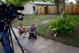 (PG8263)  Neighbors Tamiah Kibble, 8, and CJ Kibble, 5, watch the activity next to a memorial set...