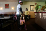 (PG2310) Tommy Wong and his daughter, Chloe, 2 1/2, spend time at the family's Cowbobas restaurant...