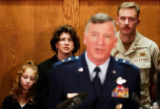 (DENVER, Colo., DECEMBER 29, 2004)  Karli, 8, Liz, and Senior MSgt, John Rohrer listen to  Major...