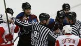 [RMN1187] Referees separate Detroit Red Wings right wing Tomas Holmstrom #96 and Colorado...