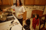 Denver, Colo.12/28/04--Hugo DeLoera, bottom, and one of his sisters, Eva, 2 of the 5 quintuplets,...