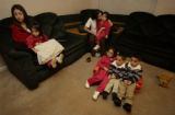 Denver, Colo.12/28/04-- The DeLoera quintuplets, born in May, 2001, now 3 1/2, watch television...