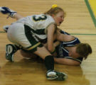 (Denver, Co.-Jan. 13, 2005)  Machebeuf's Elizabeth Pippin, (33) left, and Denver Christian's...