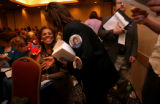 (PG6888)  With buttons on her jacket, Angela Williams, a national delegate at large, passes out...