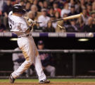 Clint Barmes breaks his bat in the 8th inning of the Colorado Rockies against the Minnesota Twins...
