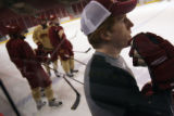 MJM323 David Carle (cq), right, watches a drill during hockey practice at the University of Denver...