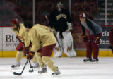 MJM502 David Carle (cq), right, takes part in a drill during hockey practice at the University of...