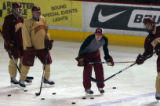 MJM681  David Carle (cq), center, takes part in a drill during hockey practice at the University...