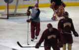 MJM795 David Carle (cq), center, takes part in a drill during hockey practice at the University of...