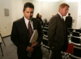 Denver Detectives Michael Martinez  and Mark Crider  walk from a press conference  after it was...