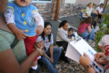 (from left to right) 35 year-old Maria Sanchez (cq) holds her son, 1 year-old Kevin Sanchez (cq),...