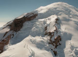 aerial of Mt. Rainier showing Ingraham flats (L), Gibraltar Rock, Disappointment Cleaver (center),...