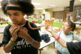0177 Gabriel Johnson, 15, a sophomore, holds earth science teacher Pattyanne Corsentinos' plays...