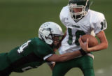 MJM090  D'Evelyn's Mark Neely, left, tackles Conifer's Craig Fowler, right, in a 3A matchup...