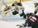 0552 Boston Bruins Tim Thmas makes a kee block on Colorado Avalanche Joe Sakics shot in the first...